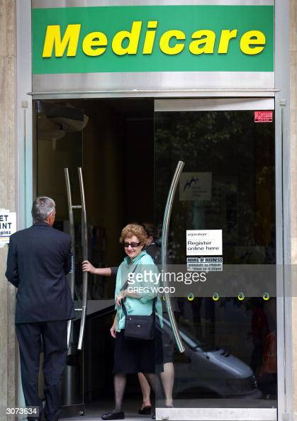 A woman leaves a Medicare office in Sydney's central business district 11 March 2004 The Australian parliament was due to vote 11 March on a...