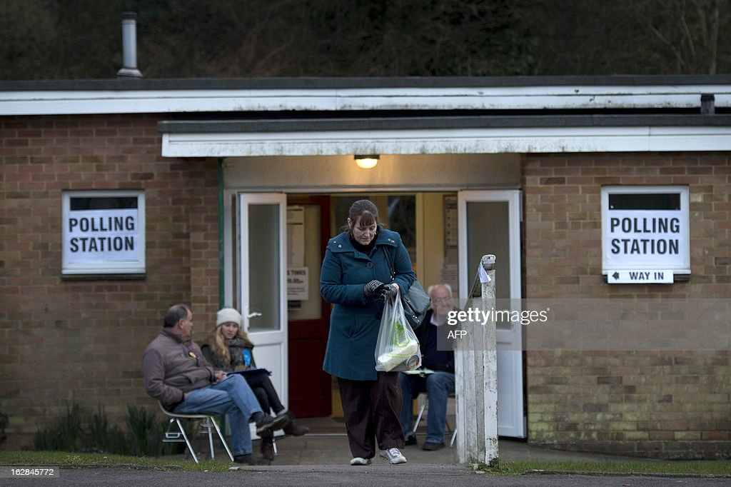 A woman leaves a polling station after casting her vote for the by-election in Eastleigh, Hampshire on February 28, 2013. Voters in the southern English town of Eastleigh went to the polls on February 28 to elect a new member of parliament in a contest that threatens serious repercussions for Britain's main parties.