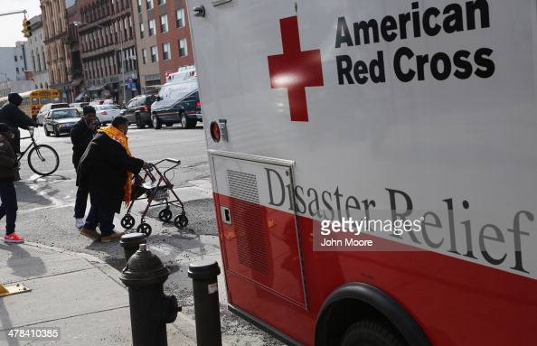 A woman leaves an American Red Cross shelter at 125th St and 3rd Avenue after staying the night a day after an explosion in East Harlem on March 13...
