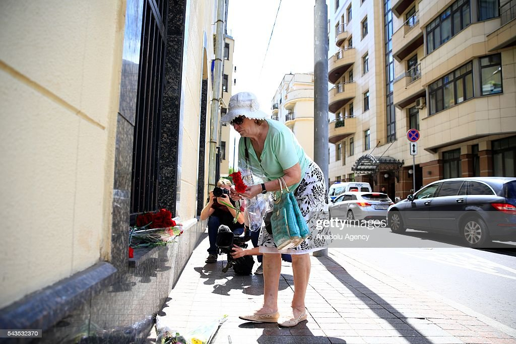 A woman leaves flowers for the victims of the terrorist attack at Ataturk International Airport outside the Turkish Embassy in Moscow, Russia on June 29, 2016. The death toll in Istanbuls airport terror attack has risen to 41, the regional governors office said Wednesday.