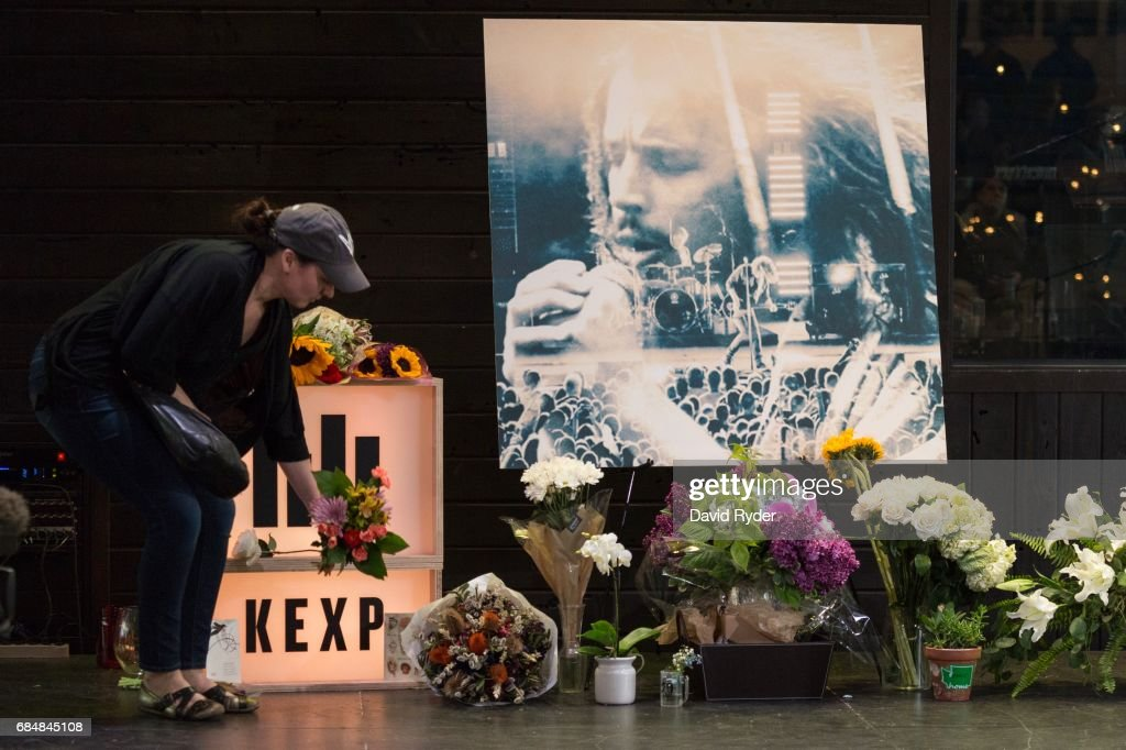 A woman leaves flowers on stage during a memorial for musician Chris Cornell at the KEXP radio studio on May 18, 2017 in Seattle, Washington. Cornell, a member of revered rock groups Soundgarden and Audioslave, was found dead overnight in Detroit at age 52.