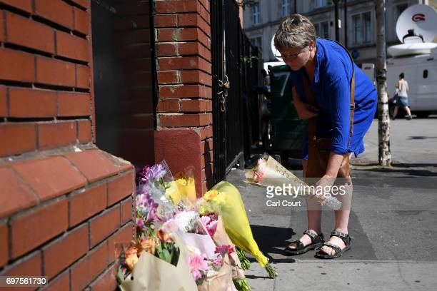 A woman leaves flowers outside Finsbury Park mosque near the scene of a terror attack in Finsbury Park in the early hours of this morning on June 19...