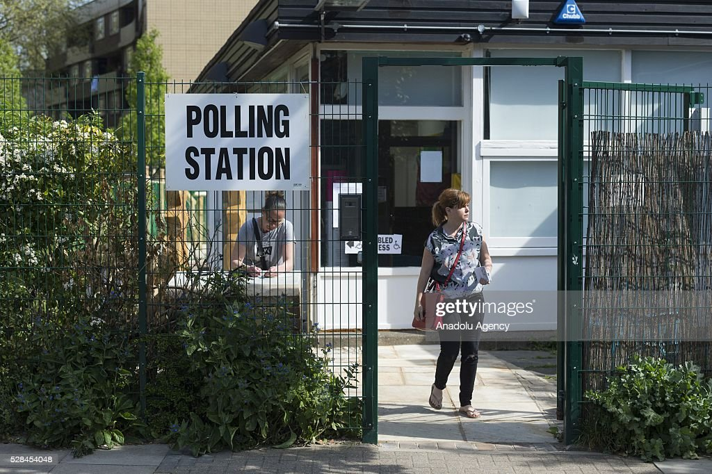 A woman leaves polling station after casting her vote within the London Mayoral Elections in North London, United Kingdom on May 05, 2016.