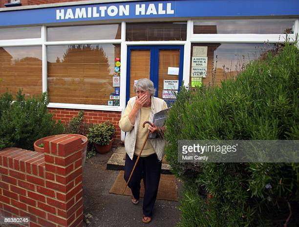 A woman leaves the Hamilton Hall hotel that is hosting controversial voluntary euthanasia campaigner Dr Philip Nitschke for workshops on assisted...
