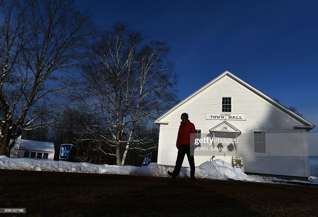 A woman leaves the town hall after voting for the first US presidential primary in Canterbury, New Hampshire, on February 9, 2016. New Hampshire began voting on February 9 in the first US presidential primary with Republican Donald Trump calling on supporters to propel him to victory and Democrat Bernie Sanders primed to upstage Hillary Clinton. The northeastern state, home to just 1.3 million people, sets the tone for the primaries and could shake out a crowded Republican field of candidates pitting Trump and arch-conservative Senator Ted Cruz against more establishment candidates led by Senator Marco Rubio. / AFP / Jewel Samad