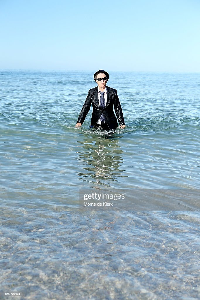 A woman leaves the water after taking part in an art installation created by surrealist artist Andrew Baines on January 20, 2013 in Adelaide, Australia.