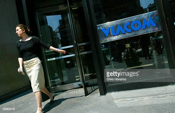 A woman leaves Viacom headquarters June 2 2003 in New York City The FCC today eased regulations on media ownership allowing broadcasters to own more...