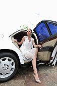 Woman leaving limousine, portrait