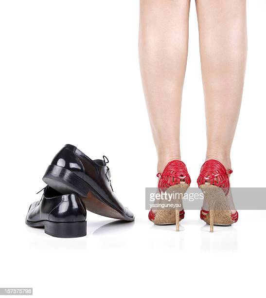 Woman Legs and Man Shoes
