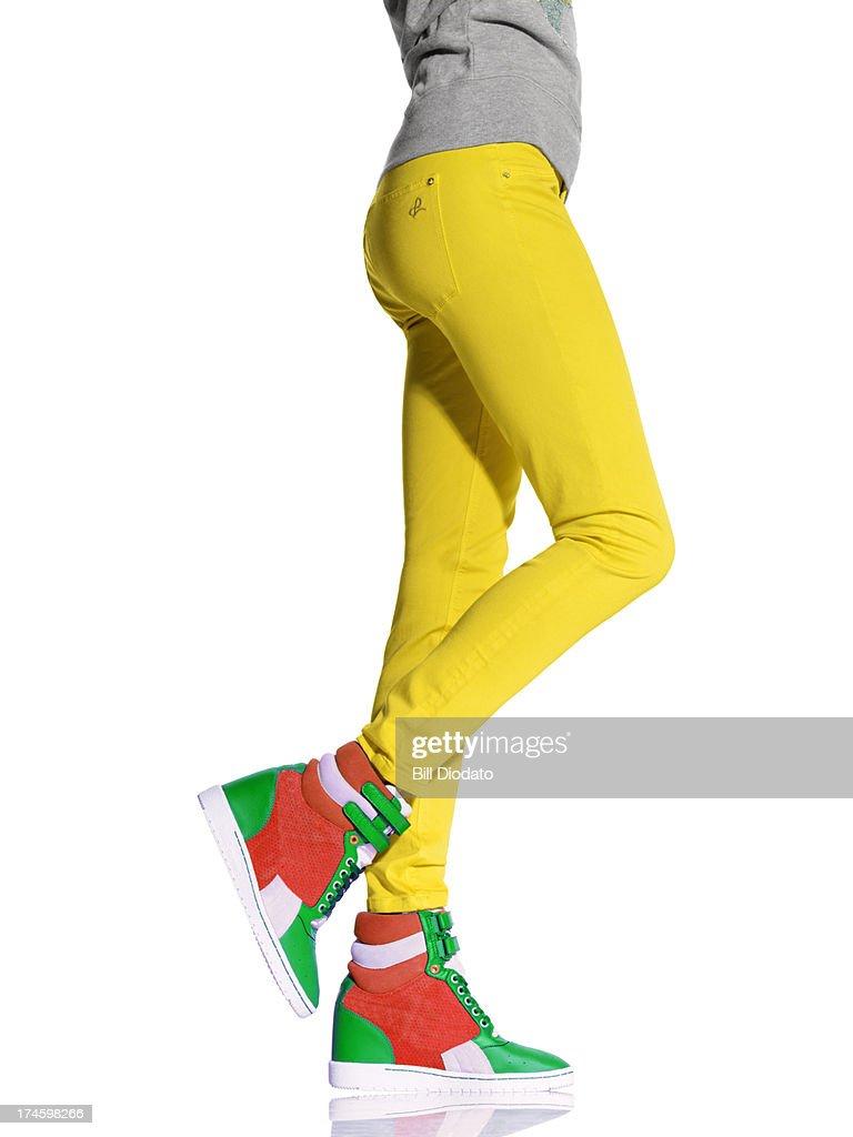 Woman legs in wedge sneakers