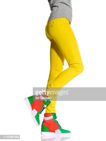Woman legs in wedge sneakers : Stock Photo