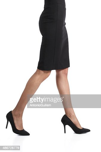 legs walking with pencil skirt and nylons stock