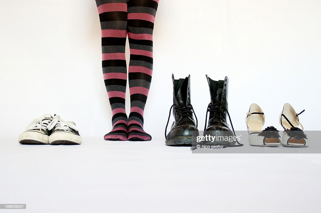 Woman legs with striped stockings and row shoes : Stock Photo