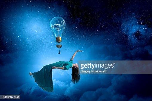 Woman levitating in sky . Mixed media : Stock Photo