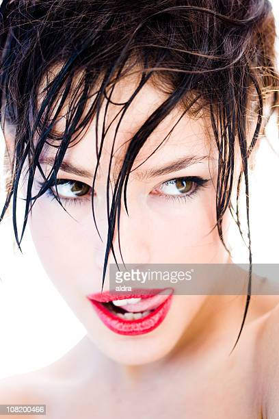 Woman Licking Lips with Wet Hair