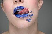 Woman licking sprinkles off lips