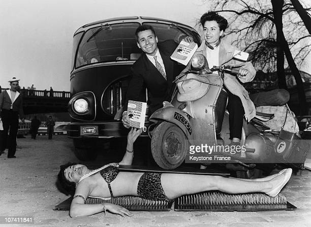 Woman Lied Down On A Bed Of Nails Bearing The Weight Of A Vespa Scooter In Italy On The Fifties