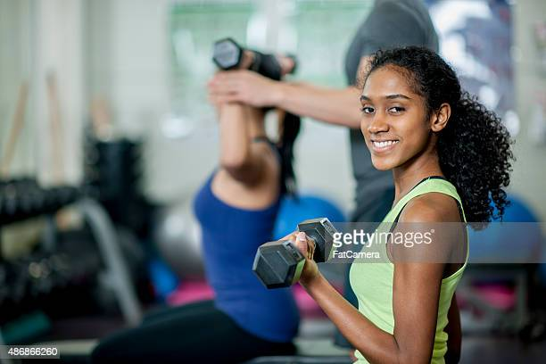 Woman Lifting Free Weights at the Gym