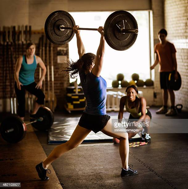 Woman Lifting Weight In Gym