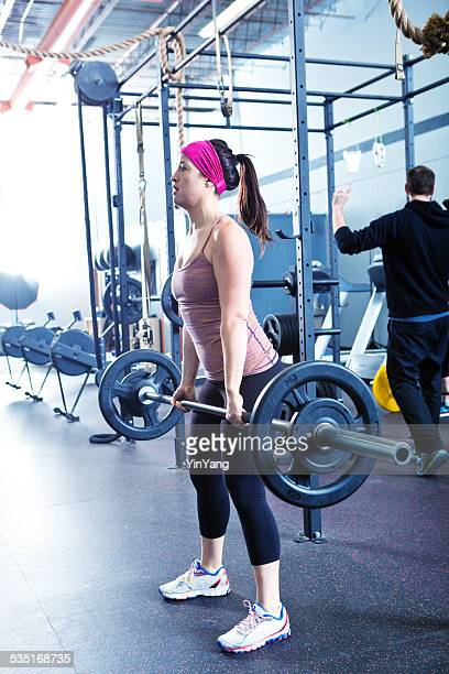 Woman Lifting Weight in Health Club Exercise
