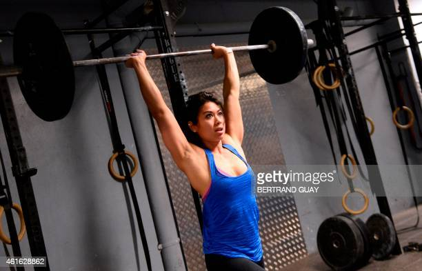 A woman lifts weight during a crossfit training in a gym in Paris on January 16 2015 AFP PHOTO / BERTRAND GUAY