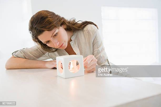 Woman lighting a candle