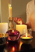 Woman Lighting Candles