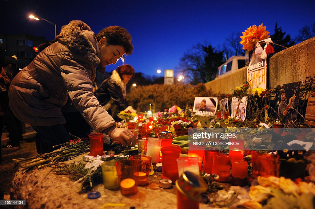 A woman lights a candle during a vigil on March 5, 2013 outside the city hall of Varna, on the site where a man who became a symbol of the three-week wave of protests against corruption, set himself on fire. Plamen Goranov, a 36-year-old amateur photographer and rock climber, died on March 3 after setting himself ablaze on February 20 in the Black Sea city of Varna. Goranov's self-immolation prompted Varna protestors to adopt his cause and turn their initial anger over high electricity bills against the long-time mayor, whom they accused of corruption and favouritism towards a local business group.