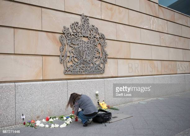 A woman lights a candle in front of British Embassy on May 23 2017 in Berlin Germany An explosion occurred at Manchester Arena as concert goers were...