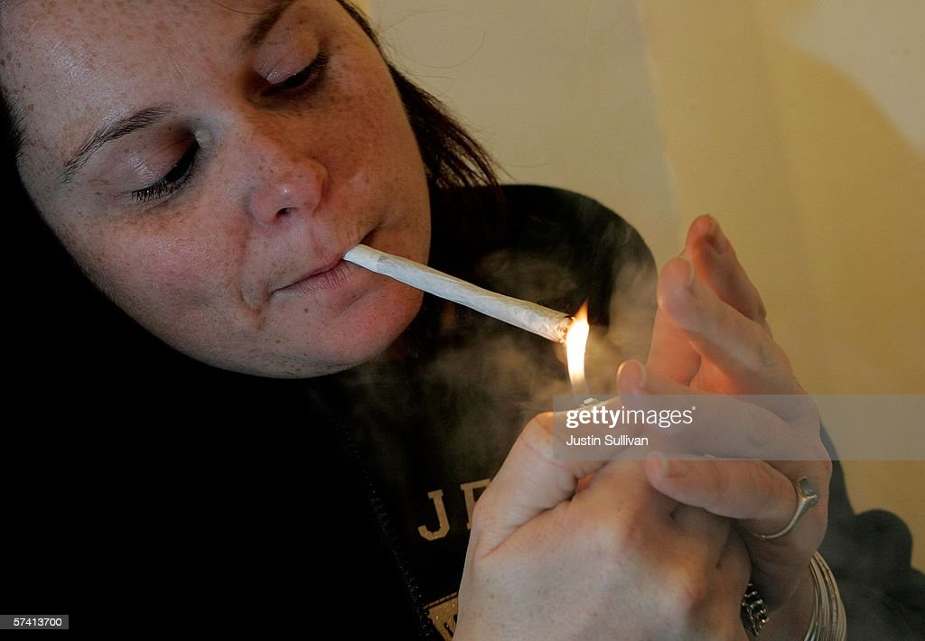 A woman lights a marijuana cigarette at the Alternative Herbal Health Services cannabis dispensary April 24, 2006 in San Francisco, California. The Food and Drug Administration issued a statement last week rejecting the use of medical marijuana declaring that there is no scientific evidence supporting use of the drug for medical treatment.