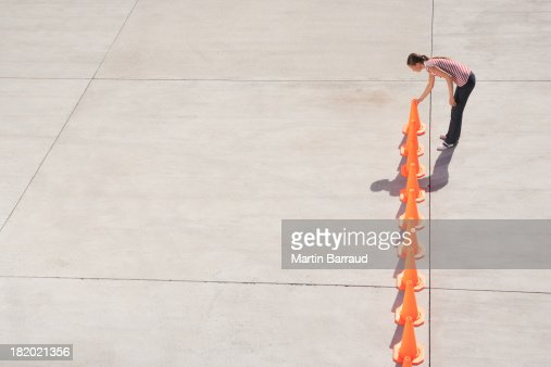 Woman lining up traffic cones
