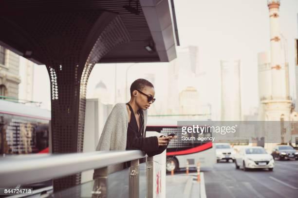 Woman listening music on the street