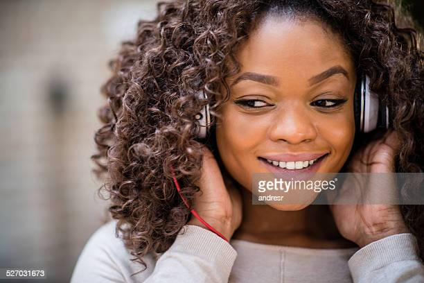 Woman listening through headphones