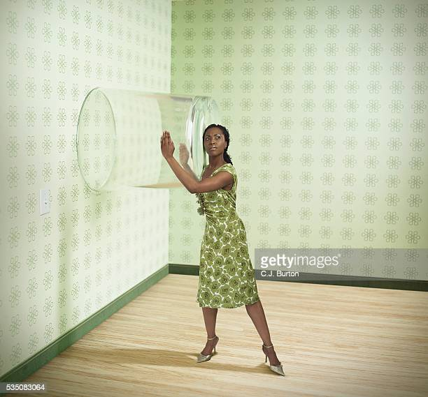 Woman listening through wall