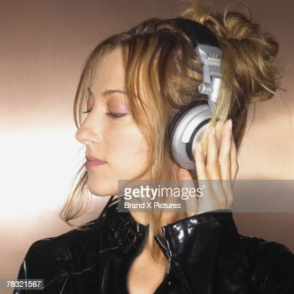 Woman listening to her music with eyes closed : Stock Photo