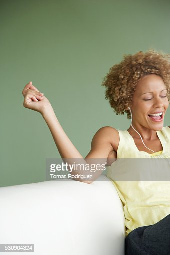 Woman listening to music and singing along