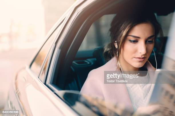 Woman listening to music in a car