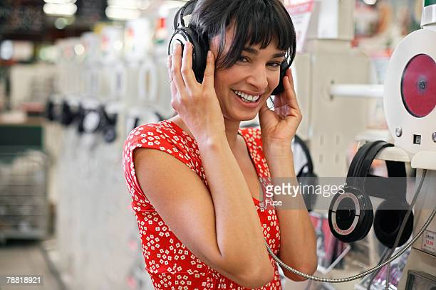 Woman Listening to Music in Record Store