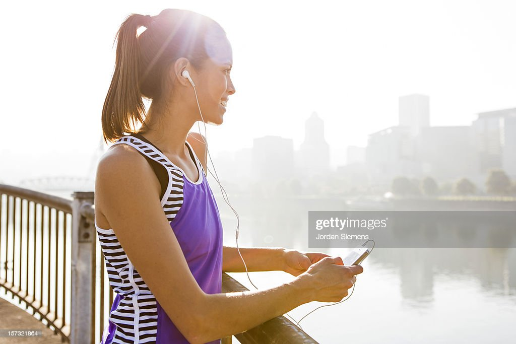 A woman listening to music. : Stock Photo