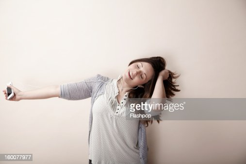 Woman listening to music : Stock Photo