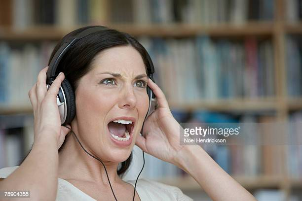 Woman listening to music, screaming