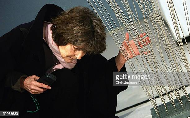 A woman listens to the sound created by Sara Scobie called 'reeds' an exhibit part of a collection of work from 60 finalists entered in the 'BlindArt...