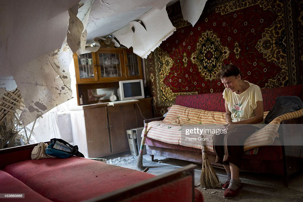 A woman living in a suburb of Donetsk cries as she sits in her damaged house after shelling overnight on August 16, 2014 in Donestk, Ukraine. Reports suggest a Russian military convoy was partly destroyed after crossing the border into the Ukraine. The US has urged Russia to cease their attempts to destabilise Ukraine which have escalated in recent weeks.
