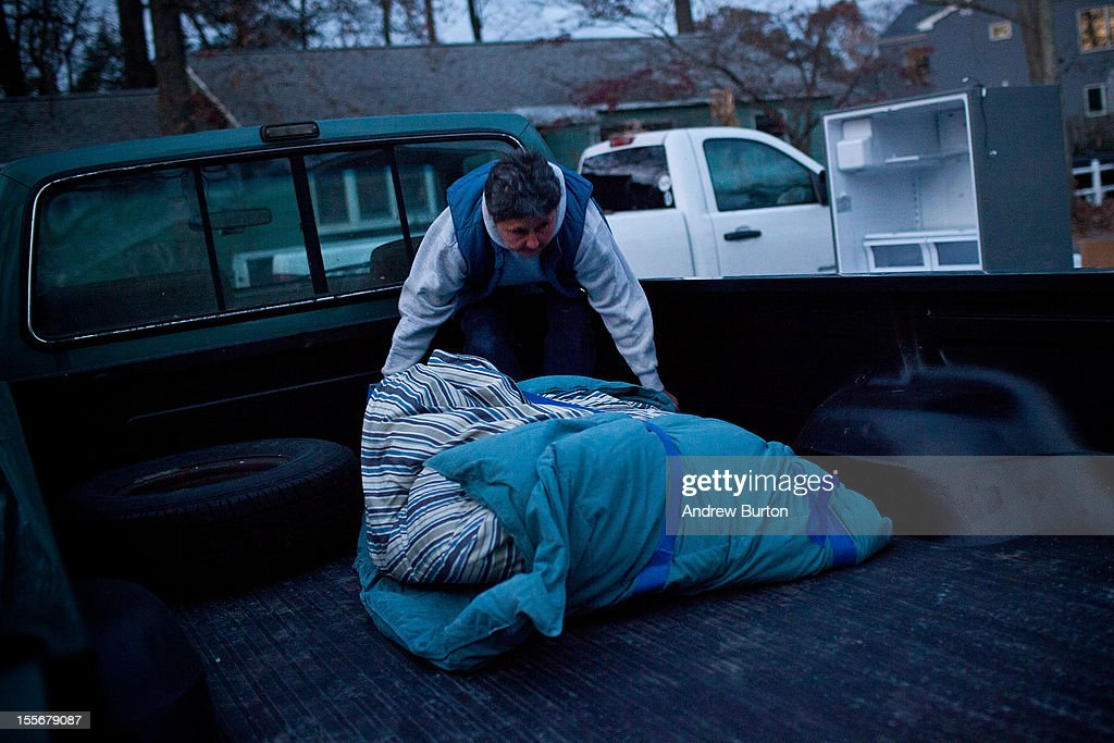 A woman loads her truck with luggage while evacuating from her home due to an approaching storm on November 6, 2012 in Brick Township, New Jersey. As the New Jersey coastline continues to recover from Hurricane Sandy, numerous polling stations have had to be relocated and aggregated together, due to storm damage and power outages.
