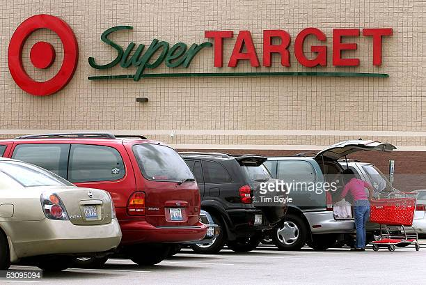 A woman loads shopping items into her van in the parking lot of a SuperTarget store June 17 2005 in Glendale Heights Illinois The larger 'big box'...