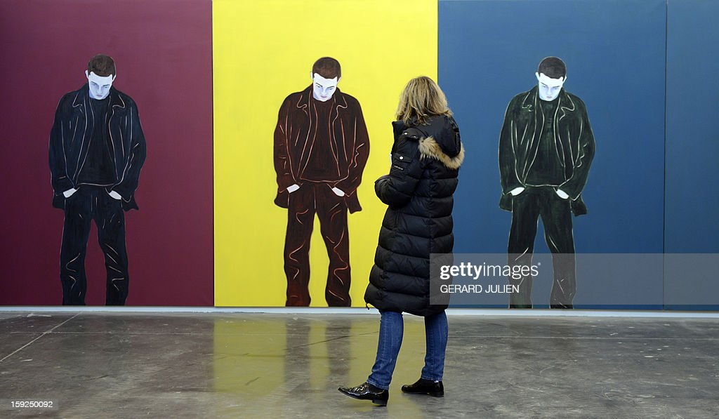 A woman look at paintings by German artist Gloria Friedmann, on display at the Tour Panorama, part of the 'Friche de la Belle de Mai' cultural area, on January 10, 2013, in Marseille, as one of a number of exhibitions opening in Marseille in relation to the city being named 2013 European 'capital of culture'. On January 12, the city will be named 'capital of culture' which will kick off a range of exhibitions and events.