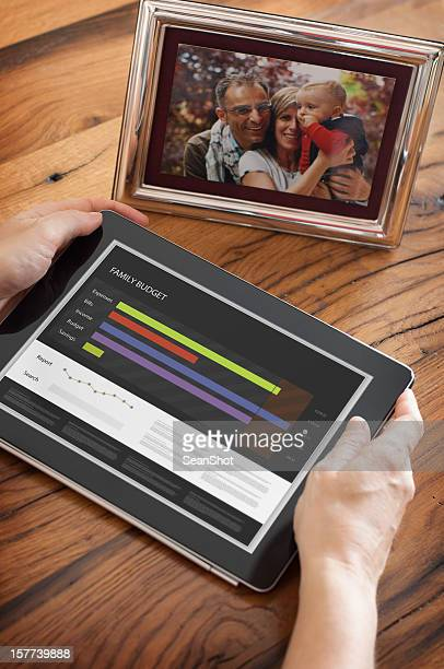 Woman Looking a Family Report on Tablet