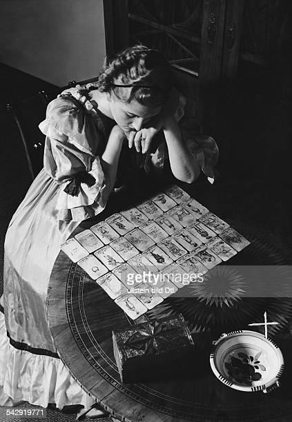woman looking a tarot cards 1950