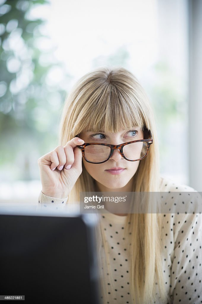 Woman looking above glasses