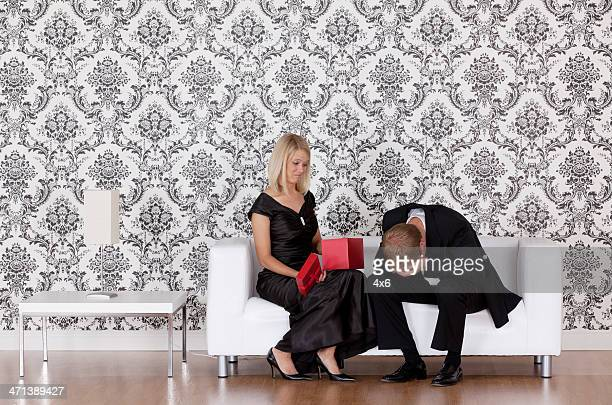 Woman looking at a gift given by her husband